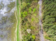 Aerial view of swamp and field with flood water near forest. Romania Stock Images