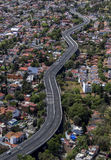 Aerial view of swaying road between houses Royalty Free Stock Images