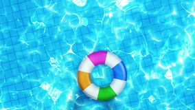 Aerial view of swimming pool. Colorful inflatable ring donut toy. Relaxation and healing concept.