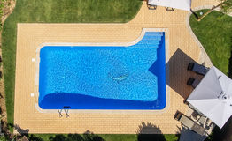 Aerial view of swimming pool outside hotel. Beautiful pool ready to holiday tourists. Top view royalty free stock photos
