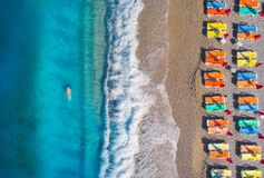 Aerial view of swimming woman in the sea and sandy beach Stock Images