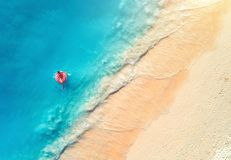 Aerial view of a swimming woman in the sea at sunset royalty free stock images