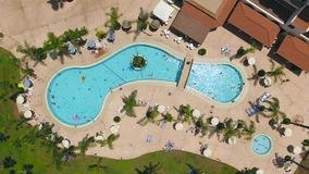 Aerial view of swimminig pool with vacationers. Aerial view of hotrl swimminig pool with vacationers stock video footage