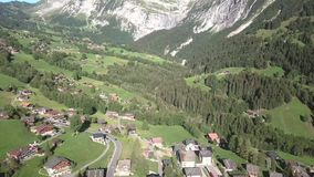 Aerial view of swiss alps, in Grindewald. Beautiful sunny day in Switzerland mountains stock footage