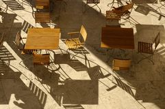 Aerial view table & Chairs. Aerial view of slatted table and chairs with shadows Royalty Free Stock Photography