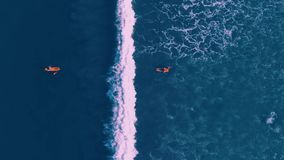 Aerial view of people surfing at Kuta beach, Bali Indonesia