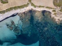 Aerial view of Tamarone beach, Plage de Tamarone, Cap Corse peninsula, Macinaggio, Corsica, France. Sea and vegetation seen from above, rocks. Sentier du royalty free stock photos