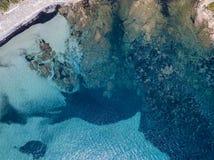 Aerial view of Tamarone beach, Plage de Tamarone, Cap Corse peninsula, Macinaggio, Corsica, France. Sea and vegetation seen from above, rocks. Sentier du stock image