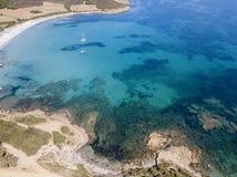 Aerial view of Tamarone beach, Plage de Tamarone, Cap Corse peninsula, Macinaggio, Corsica, France. Sea and vegetation seen from above, rocks. Sentier du royalty free stock photo