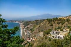 Aerial view of Taormina city, mediterranean sea and Mount Etna Volcano - Taormina, Sicily, Italy Royalty Free Stock Images