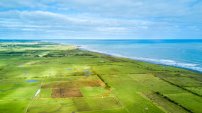 Aerial view on Tasman coast with farms and stock paddocks. Taranaki region, New Zealand Royalty Free Stock Image