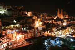 Aerial View Taxco, Guerrero. Taxco de Alarcon in the Mexican state of Guerrero. Night scene of the city with the Santa Prisca Church in the background Stock Photography