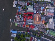 Aerial view of temple, Wat Devaraj Kunchorn Worawihan, Thai architectures. Close up of red roofs. Top view.  stock photos