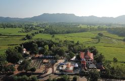 Aerial view of temples in rural villages in the rainy season. royalty free stock images