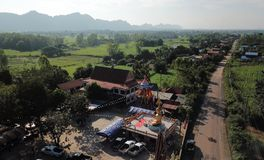 Aerial view of temples in rural villages in the rainy season. royalty free stock photography