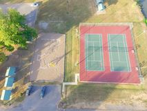 Aerial tennis court at public park in Ozark, Arkansas, USA. Aerial view tennis court at public park in Ozark, Arkansas, America at sunset. Top view outdoor court royalty free stock photography