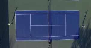 Tennis match between two young players stock video footage
