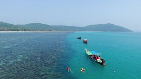 Aerial view on Thai traditional boats in Thailand. Samui island. Clear water and snorkling. Beautiful landscape stock footage