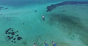 Aerial view on Thai traditional boats in Thailand. Samui island. Clear water and snorkling. Beautiful landscape stock video