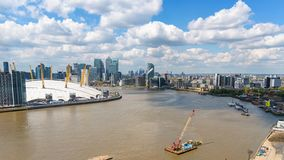 Aerial view of Thames River in eastern London. Aerial view of Thames River and Greenwich Peninsula in London, UK royalty free stock photos