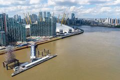Aerial view of Thames River in eastern London. Aerial view of Thames River and Greenwich Peninsula in London, UK royalty free stock photo