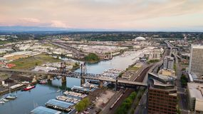 Aerial View Thea Foss Waterway Tacoma Washington Mt Rainier Visible. Mt Rainier stands in the background above the tide flats and the Port of Tacoma stock photo