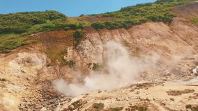 Aerial View. Thermal spring gushes out of the ground. Hot spring water in the mountains.  stock footage
