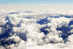 Aerial view of thick clouds over the land, the landscape. The texture of the scenic sky illuminated by the rays of the sun Stock Image