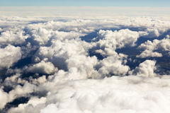 Aerial view of thick clouds over the land, the landscape. The texture of the scenic sky illuminated by the rays of the sun Royalty Free Stock Photography