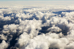 Aerial view of thick clouds over the land, the landscape. The texture of the scenic sky illuminated by the rays of the sun Stock Photo