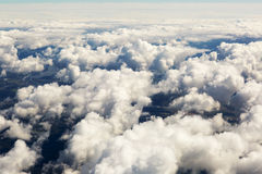 Aerial view of thick clouds over the land, the landscape. The texture of the scenic sky illuminated by the rays of the sun Stock Photography