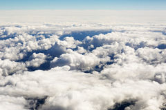 Aerial view of thick clouds over the land, the landscape. The texture of the scenic sky illuminated by the rays of the sun Stock Photos