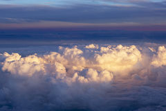 Aerial view of thick clouds over the land, the landscape. The texture of the scenic sky during sunset Royalty Free Stock Photography
