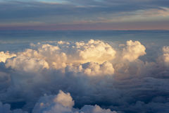 Aerial view of thick clouds over the land, the landscape. The texture of the scenic sky during sunset Stock Photography