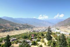 Aerial view of Thimphu City with Bhutanese traditional style houses near a river in Paro, Bhutan