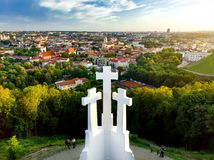 Aerial view of the Three Crosses monument overlooking Vilnius Old Town on sunset. Vilnius landscape from the Hill of Three Crosses Royalty Free Stock Photos