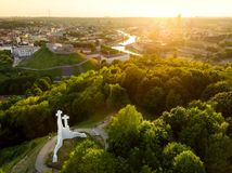 Aerial view of the Three Crosses monument overlooking Vilnius Old Town on sunset. Vilnius landscape from the Hill of Three Crosses Stock Image