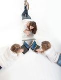 Aerial view of three girls with computer royalty free stock photos