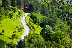 Aerial view of three motorcyclists on a rural road Royalty Free Stock Photos