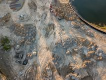 Aerial view of three multi-colored dump tip trucks unloading in royalty free stock photo