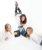 Aerial view of three smiling girls with computer Royalty Free Stock Photography