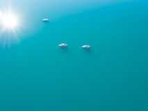 Aerial view of three yachts sailling on azure water. Beautiful aerial view of three yachts sailling on azure water Royalty Free Stock Images