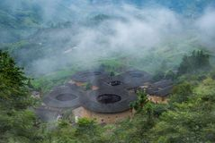 Aerial view of Tianluokeng Tulou cluster with mist royalty free stock image