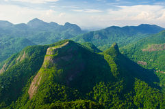 Mountains in Rio de Janeiro. Aerial view of Tijuca Forest with Pedra Bonita in the front Stock Photos