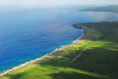 Aerial view, Tinian coastline. A beautiful aerial view of Tinian's blue and green coastlines and cliff lines Stock Photo