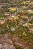 Aerial view of the tiny town of Gormanston. Queenstown, Tasmania, Australia, Ocotber 10, 2013: Aerial view of the tiny former mining town of Gormanston on the stock photos