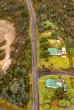 Aerial view of the tiny town of Gormanston. Queenstown, Tasmania, Australia, Ocotber 10, 2013: Aerial view of the tiny former mining town of Gormanston on the stock images