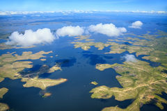 Aerial view to archipelago under few fluffy clouds royalty free stock image