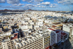 Aerial view to Arrecife with volcanoes in the background Royalty Free Stock Image