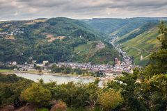 Aerial view to Bacharach town and hills of Rheinland-Pfalz land with river Rhine from tourist route. Landscape with german hills and agriculture and grape fields stock photography